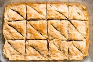 pan of homemade baklava cut into triangles