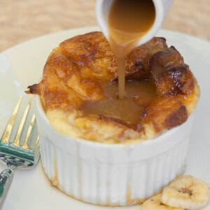 ramekin with bread pudding and caramel sauce