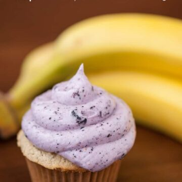 a cupcake with blueberry frosting with bananas