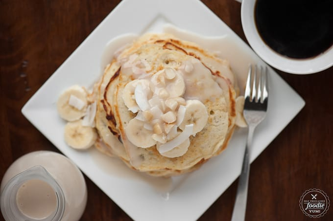 banana mac pancakes with coconut syrup on plate