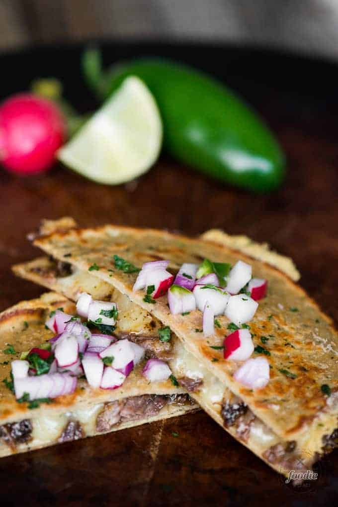 Barbacoa Quesadillas with pickled radish topping