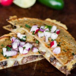 barbacoa beef quesadilla with radish topping