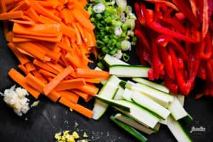 raw vegetables on cutting board for Beef Stir Fry recipe
