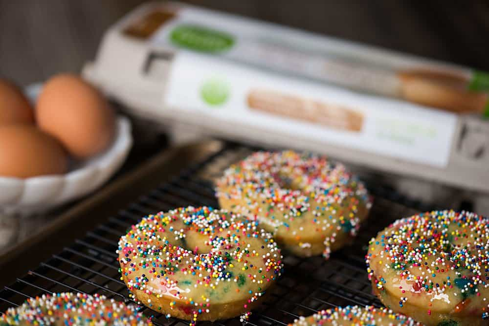 Colorful Birthday Cake Baked Donuts are a real treat for any occasion. This easy to make recipe will put a smile on anyone's face!