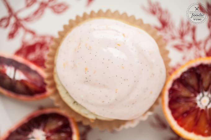 top of a frosted orange cupcake with vanilla bean