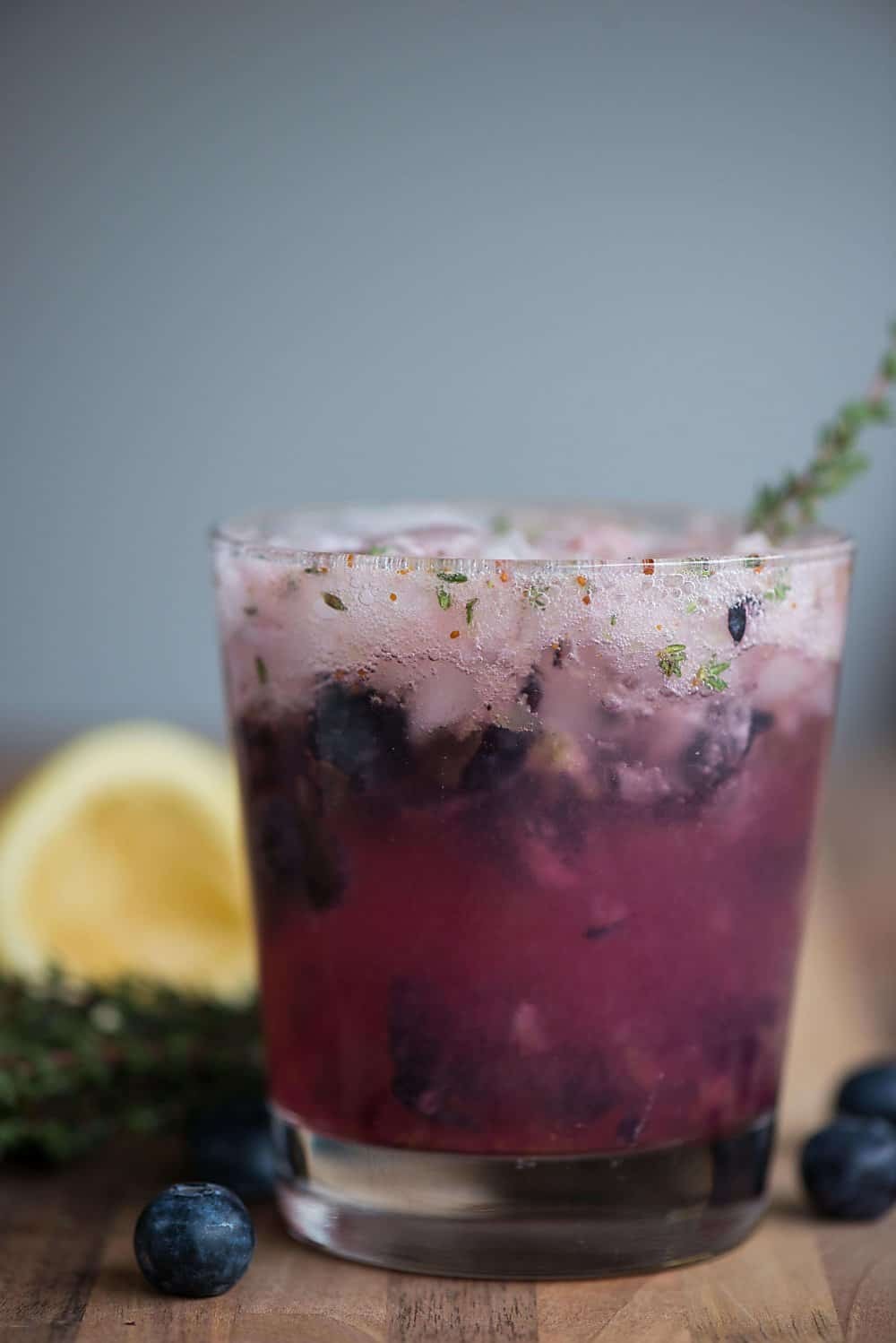 Summer cocktails don't get much easier than this tart, sweet, and refreshing Blueberry Thyme Crush Cocktail made with vodka or gin!