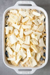 slices of butter on cobbler topping