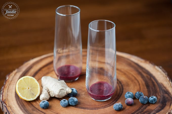 champagne flutes with blueberry ginger puree