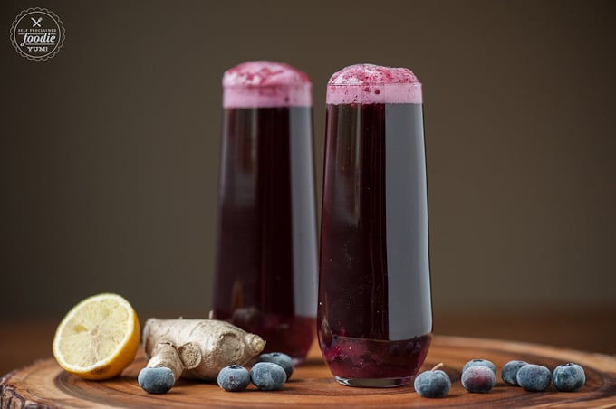glass of blueberry ginger bellini