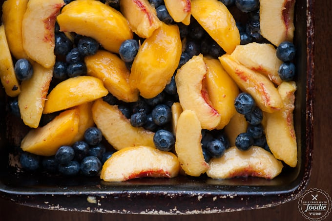 sliced peaches and fresh blueberries