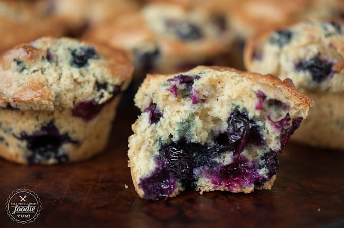 A close up of a homemade blueberry muffin split in half