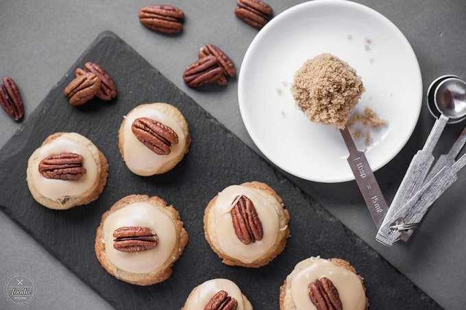 Super soft Brown Sugar Pecan Cookies with a brown sugar frosting are an easy to make treat perfect year round, or for the holidays, that everyone will love!