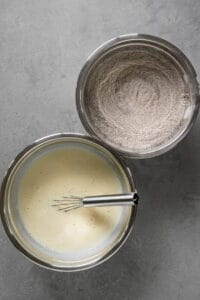 wet and dry ingredients in separate bowls for pancake recipe