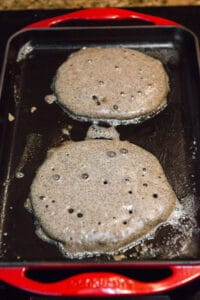 Buckwheat Pancakes on griddle prior to being flipped