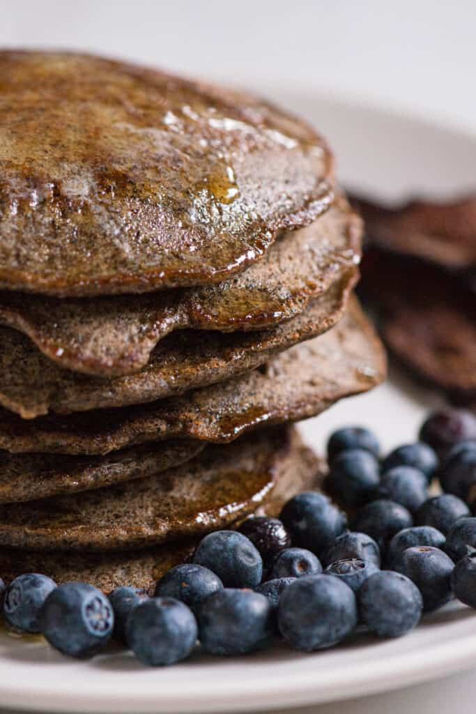 close up of a stack of Buckwheat Pancakes with blueberries