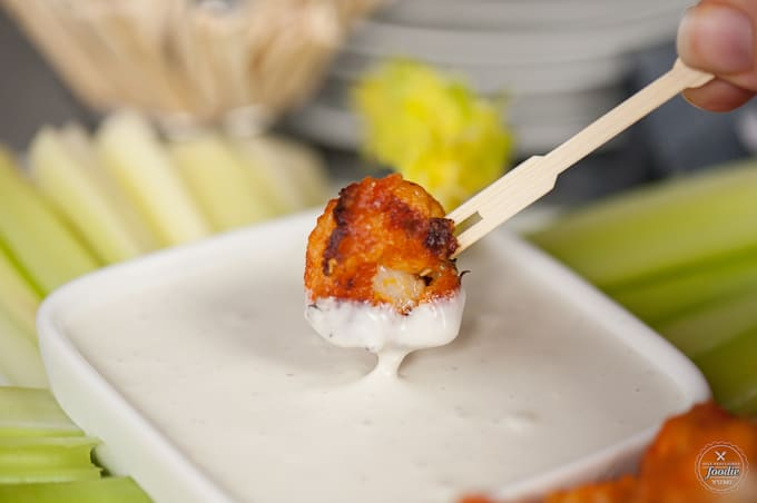 Buffalo Cauliflower Bites taste so much like traditional chicken wings, but are a healthy vegetarian version perfect for a light snack.