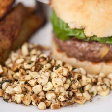 sauteed corn next to a burger