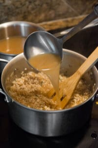 adding hot chicken broth to risotto