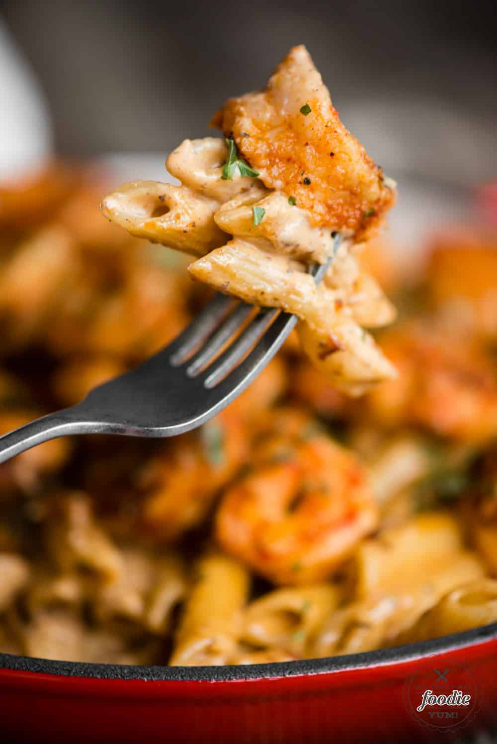 cajun shrimp and pasta on fork
