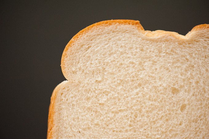 A close up of a slice of white bread