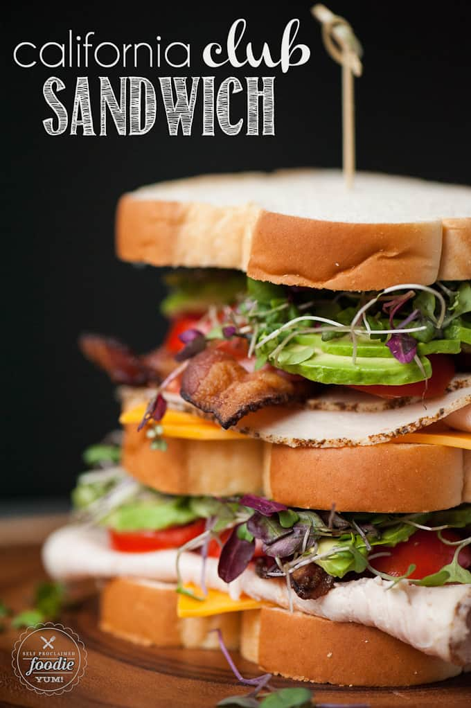 stacked club sandwich with avocado and sprouts