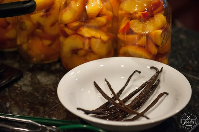 Every summer I make enough low sugar organic Canned Vanilla Bean Peaches to last me all year. Our family loves them and they make great DIY gifts as well!