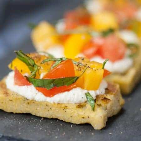 Grilled Caprese Polenta Bites are a tasty and simple appetizer that is not only easy to make, but perfect for your next summer cookout or outdoor adventure.