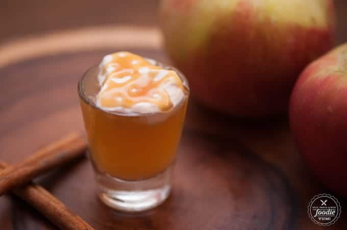 apple pie shot with caramel and whipped cream