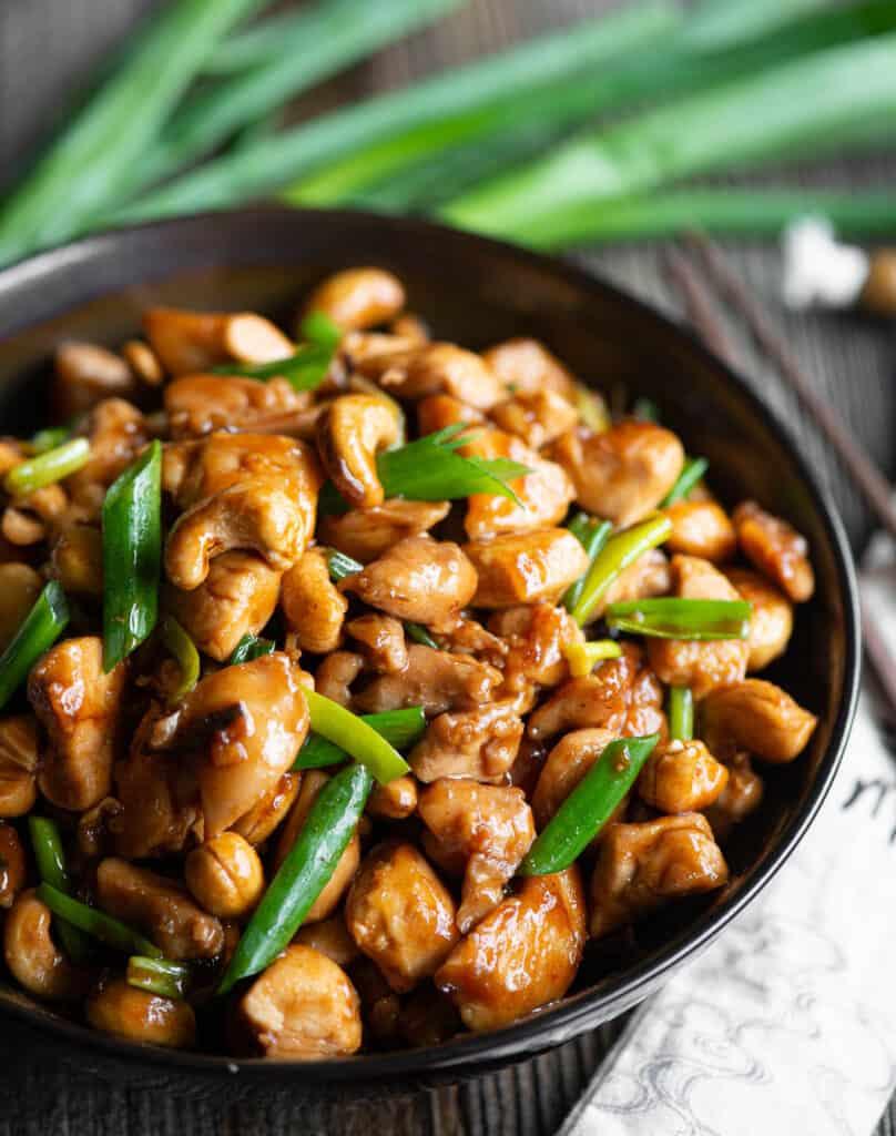 homemade Cashew Chicken in dark bowl