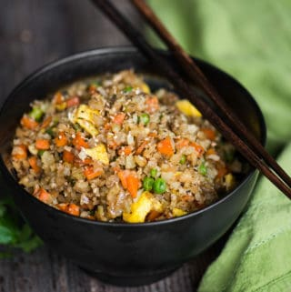 "Cauliflower Fried Rice is an easy to make a tasty, low carb meal packed with vitamins and flavor! This ""rice"" is so good you won't even think you're eating healthy! Minced raw cauliflower is the perfect substitute for rice in this recipe."