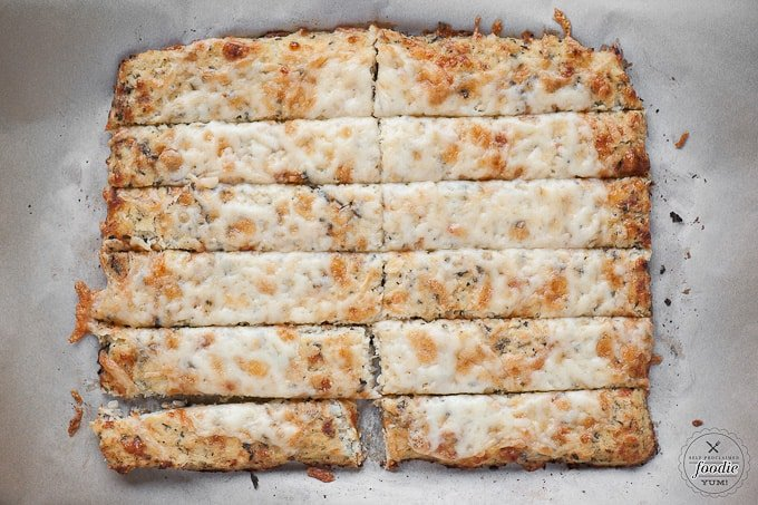 Cauliflower Garlic Breadsticks use an entire head of cauliflower to make a cheesy, gluten free, low carb alternative to traditional breadsticks.