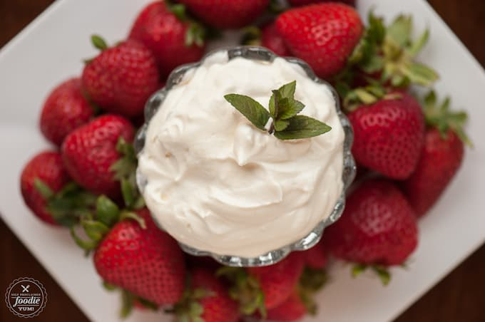 This easy to make smooth and creamy Cheesecake Fruit Dip has just enough sweet and has a secret ingredient that will have everyone begging for more.