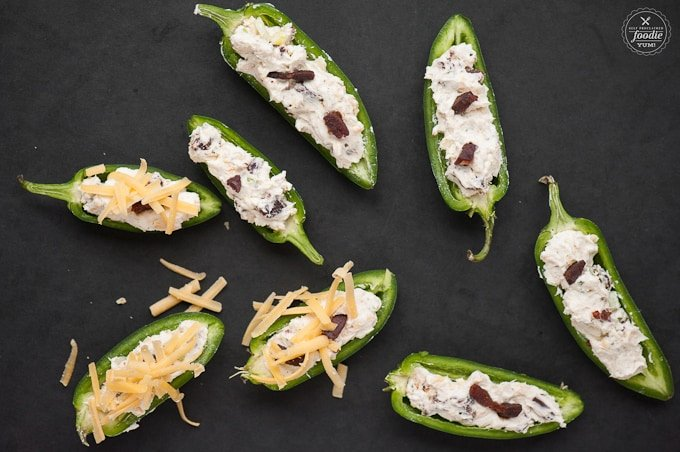 These spicy and zesty Cheesy Bacon Ranch Jalapeno Poppers make the perfect two bite appetizer for any game day celebration.