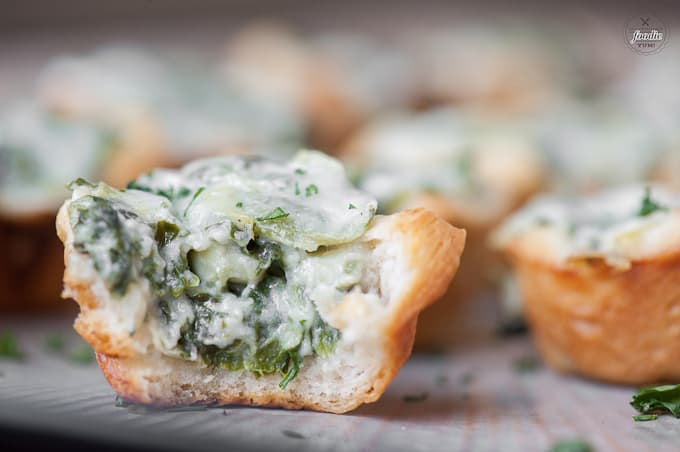 If you're looking for the perfect two bite party appetizer, these Cheesy Spinach Artichoke Bites are definitely a favorite.