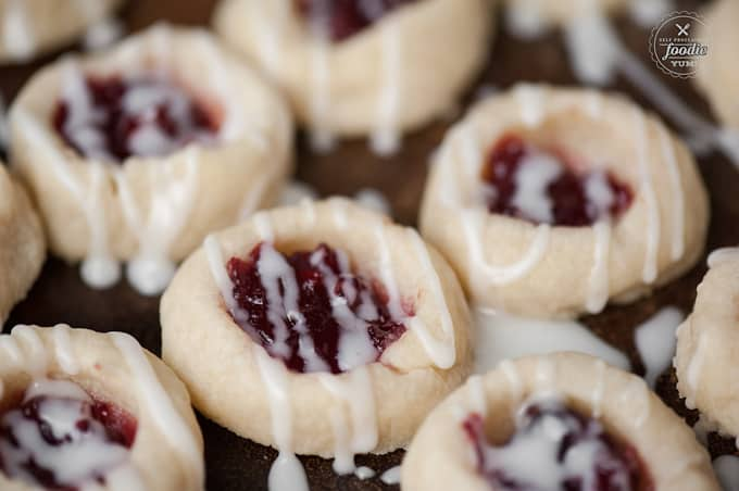 Cherry Almond Thumbprints pair the delicious flavors of cherry preserves and almond to make a buttery shortbread cookie that is perfect for the holidays.