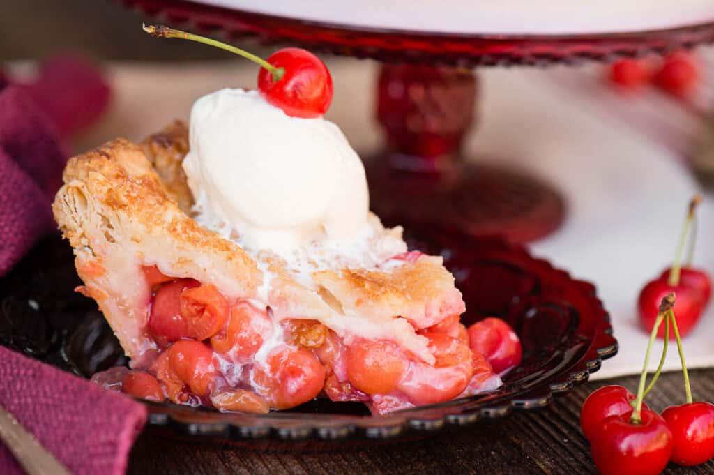 slice of Cherry Pie with ice cream on top