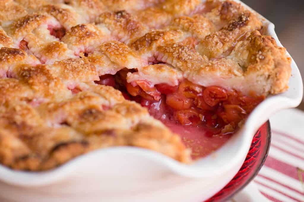 homemade Cherry Pie with slice cut out