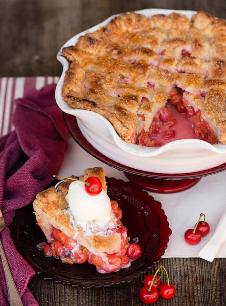 slice of Cherry Pie on red plate