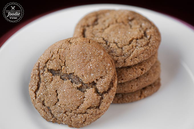 chewy molasses sugar cookies on white plate