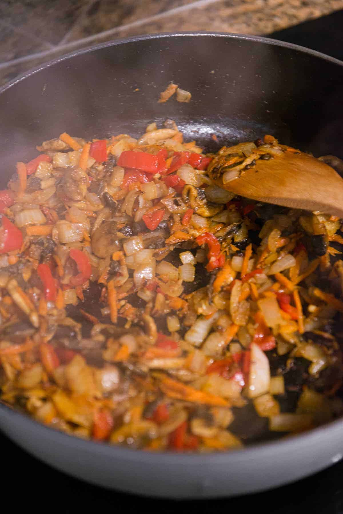 stirring diced vegetables for Chicken Cacciatore recipe
