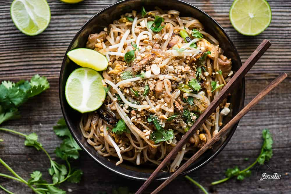 chicken pad thai with chopsticks