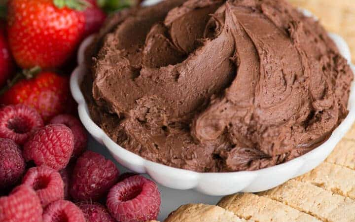 bowl chocolate cream cheese fruit dip with fruit and cookies