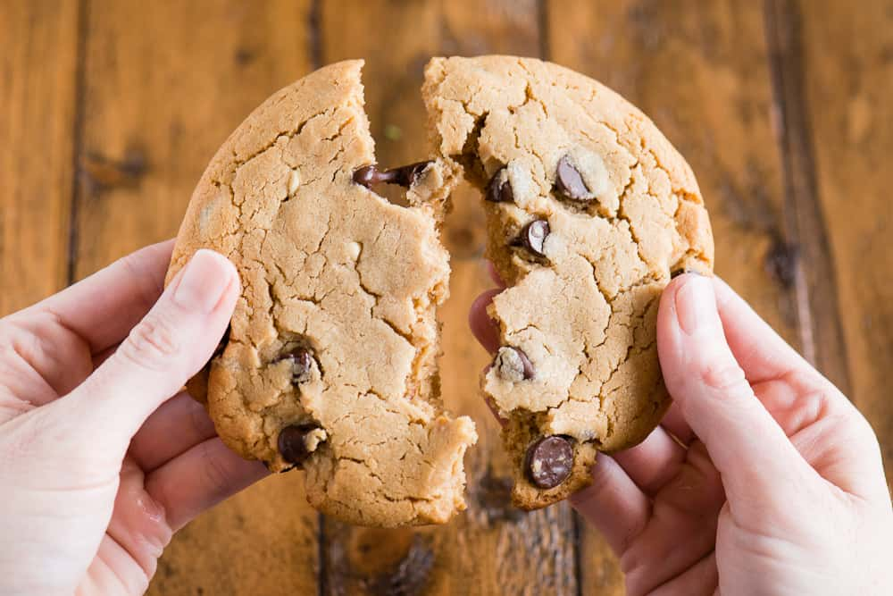 large chewy soft Chocolate Chip Peanut Butter Cookies broken in half