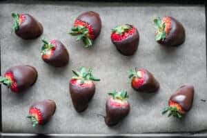 homemade chocolate covered strawberries on parchment