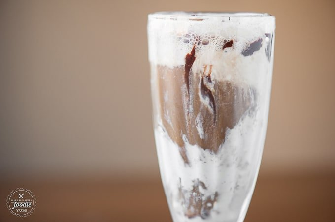 Make a grown up boozy dessert drink this St. Patrick's Day and enjoy a delicious Chocolate Guinness Float, made with homemade ice cream & chocolate sauce.