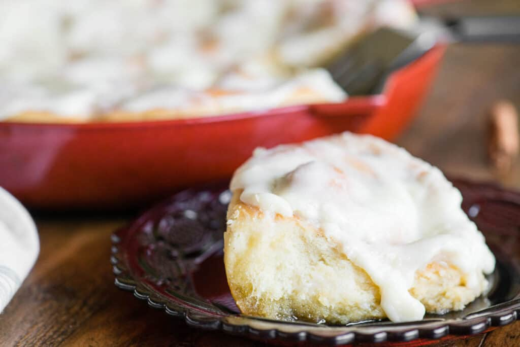 Homemade Cinnamon Roll covered in cream cheese frosting