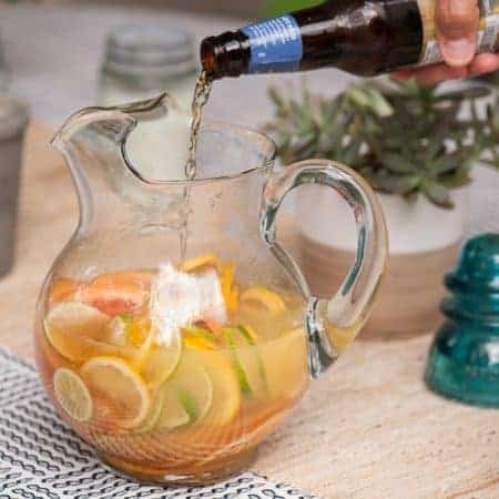 Beer cocktails are a fantastic way to incorporate beer to create tasty new adult beverages. This Citrus Beer Sangria that is sweet, bubbly, and refreshing!