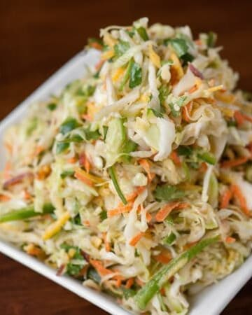 Citrus Cumin Coleslaw is a healthy and delicious side dish that is the perfect accompaniment to spicy sliders or fish tacos. Its perfect for Cinco de Mayo!