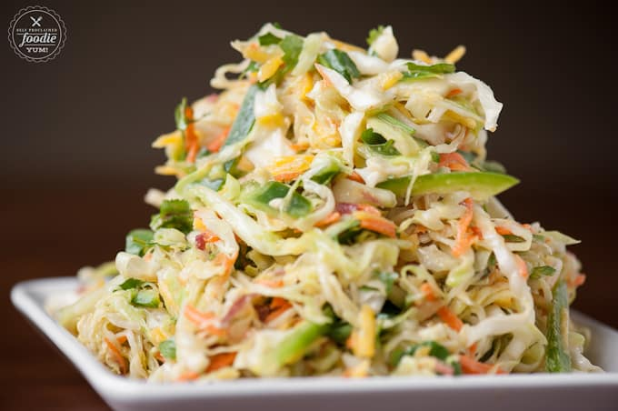 pile of homemade coleslaw with green cabbage, carrot and jalapeno