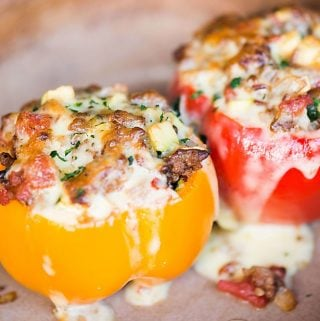 Classic Stuffed Peppers stuffed with rice, ground beef, tomatoes, and zucchini are a complete meal that can be made ahead.